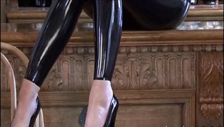 Latex bartender Sarahs catsuit service and glamour brunette